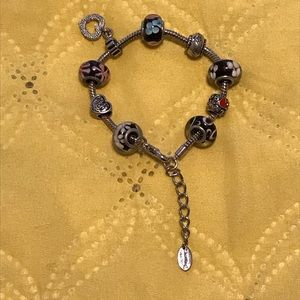 Accessories - A beautiful bracelet with multiple charms.